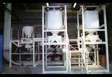 Process de vidange de big bag avec doseur et transport pneumatique