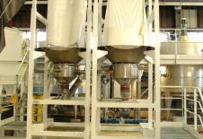 Stations de vidange de big bag avec vis de dosage